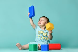 Are you worried that your little one isn't hititng their milestones? Find everything you need to know regarding early intervention, what that means, and how to get help.